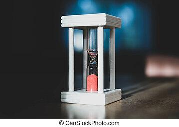 Hourglass on a dark background