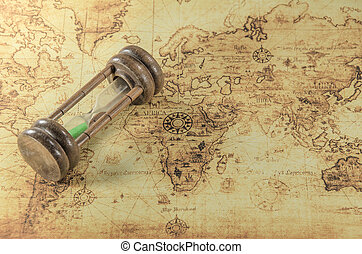 Hourglass on a old world map