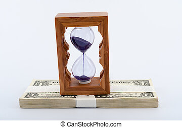 Hourglass on money