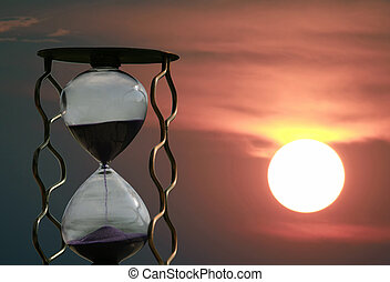 hourglass on the background of a sunset