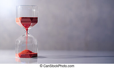 Hourglass on white table, Time passing concept