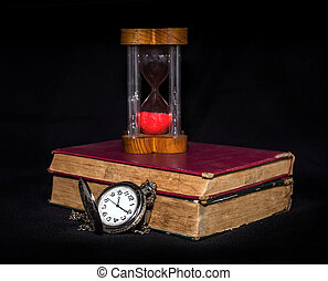 hourglass ,stopwatch and old book still life