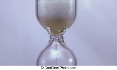 "Hourglass Time Lapse - Time lapse of hourglass with ""sands..."