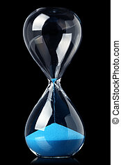 Hourglass with blue sand showing the passage of time