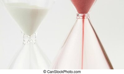 Hourglasses with white and red sand,close up image
