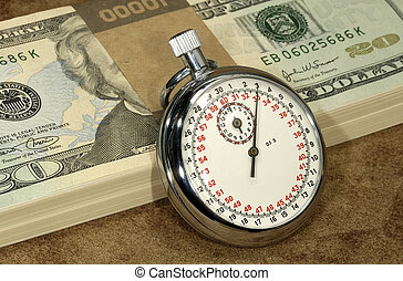 Hourly Wages - Stopwatch and Money - Hourly Wages Concept