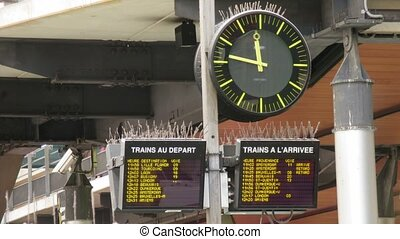 Hours at station in Paris, France. Under hours of board with departure of trains. Time lapse.
