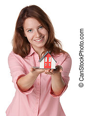 House agent offer (tout) new building represented by model