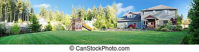 House and backyard with yard and play ground. - Panorama...