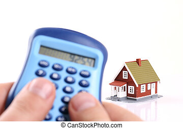 House and calculator in hand.