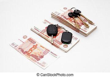 House and car keys on money
