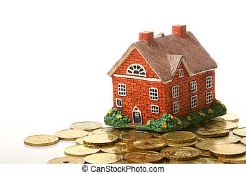 house and coins - nice house and gold money over white...