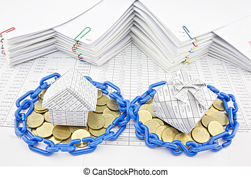 House and gift box on pile of gold coins