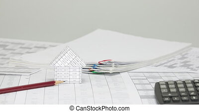 House and pencil with blur pile overload paper time lapse -...