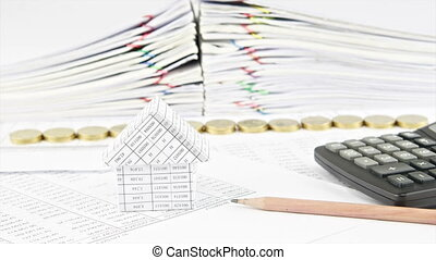 House and pencil with step pile of