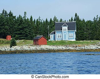 House and shed - Blue house with white trim and a red shed...