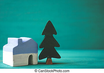 House and tree on green background