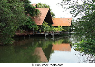 House at tropical river, Thailand