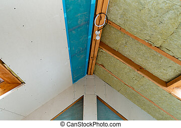 House attic insulation and renovation. Drywall construction