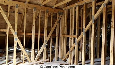 House attic under construction walls and ceiling material in...
