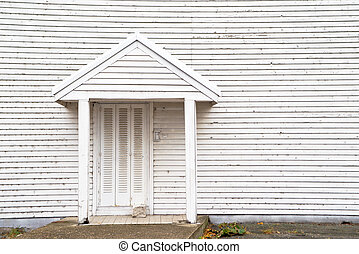 House backdoor - White wooden house backdoor on a clody ...