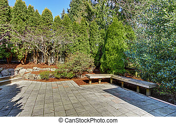 House backyard with bench and garden