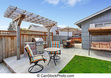 House backyard with patio area - House backyard with...