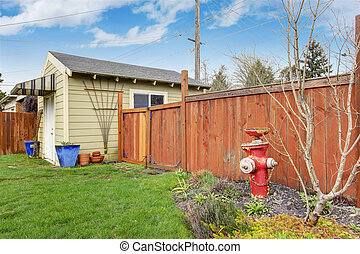 House backyard with shed - Fenced backyard. View of shed ...