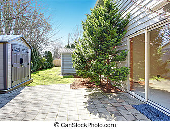 House backyard with small shed