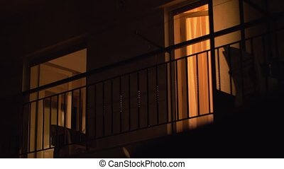 House balcony with open doors at night - Night view of the...