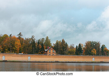 house behind the wall on the lake