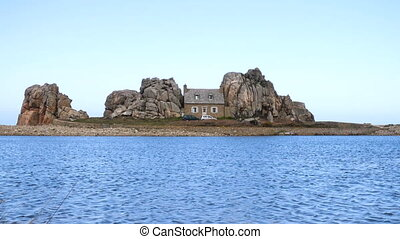 House between the rocks - PLOUGRESCANT, FRANCE - APRIL 04,...