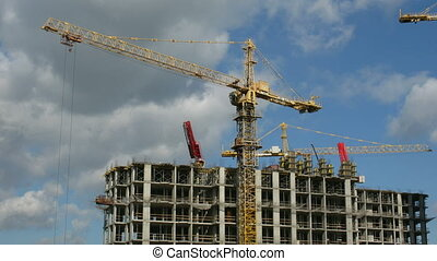 House building: a building and the crane against the sky