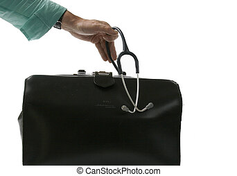 House call - doctor takes stethoscope out of doctor\'s bag....