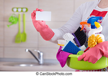 House cleaner with business card - House keeper holding...