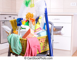 House cleaning concept - Cleaning supplies in plastic basket...