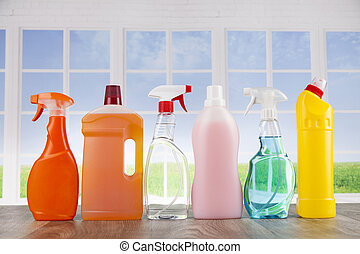 House cleaning product on wood table and window background -...