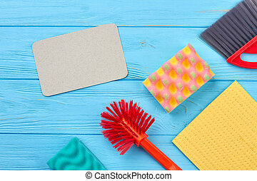 House cleaning products on wooden table.