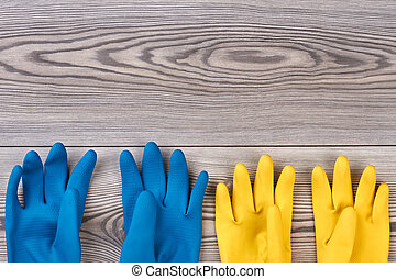 House cleaning protective gloves. Blue and yellow rubber...