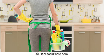 house cleaning service - back view of cleaning lady standing...