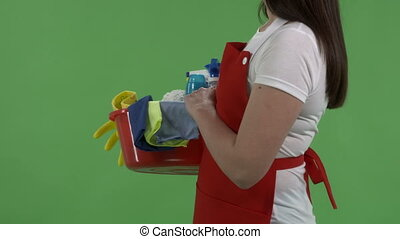 House cleaning service worker with washing fluids and rags...