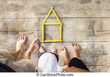 House concept with yellow meter on wooden floor