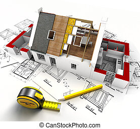 Aerial view of a house under construction, with blueprints and architect work tools