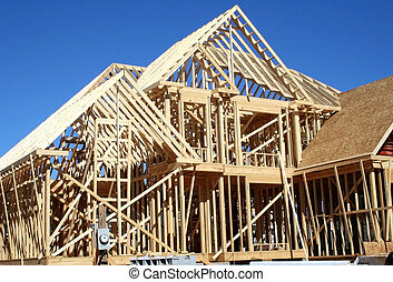 house construction - house in the framing stage of...