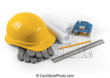 house construction project - tools and equipment on blueprints