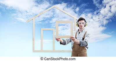 house construction renovation concept handyman carpenter man show the model of a wooden house isolated on blue sky background, ecology house concept