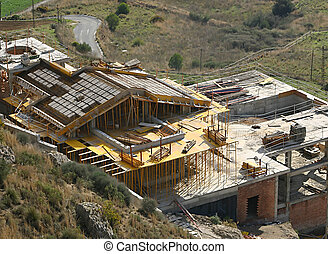 house construction - house under construction against the...