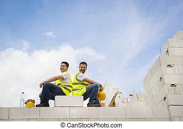House construction - Construction Contractors building a big...