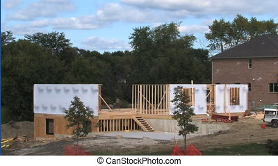 House Construction Time Lapse - Time Lapse with stages of an...