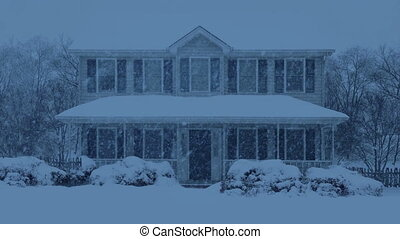 House Covered In Snow In The Evening
